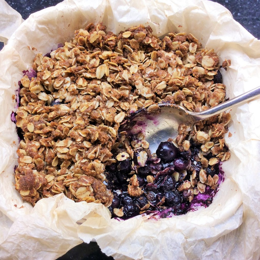 Blueberry Crisp using frozen blueberries, make sure you line the an with parchment paper for an easier clean up