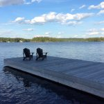 Muskoka chairs on the dock.