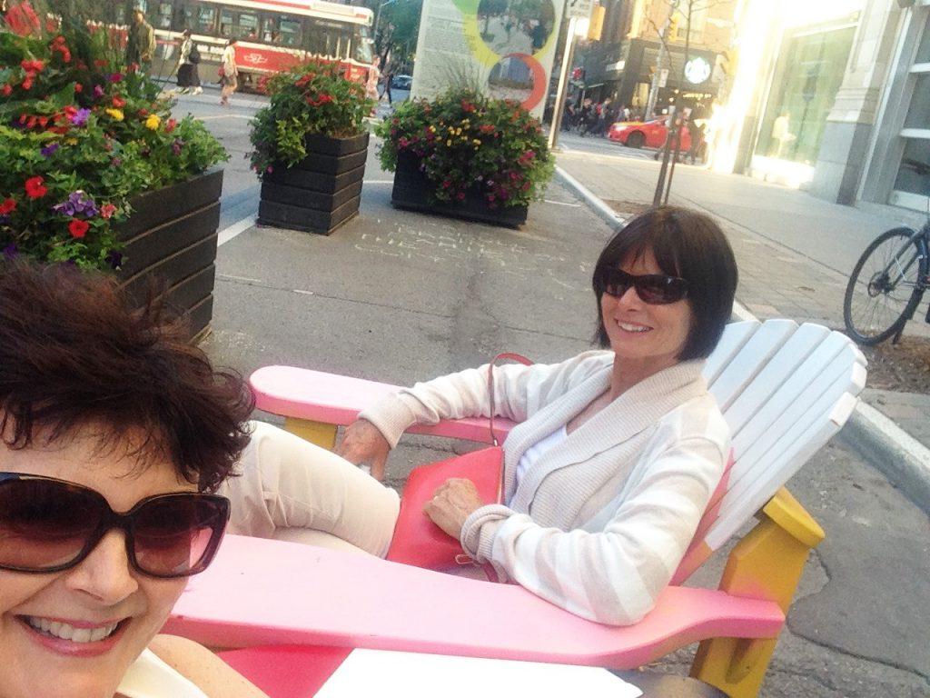 Sitting on the Muskoka chairs on John Street