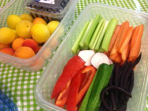 Cut up vegetables ready to be added to a lunch. Purple beans, red peppers, radishes, celery or carrots.