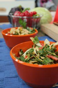 main course vegetarain salad with peanuts in an orange bowl