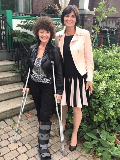 on crutches and dressed up for TIFF