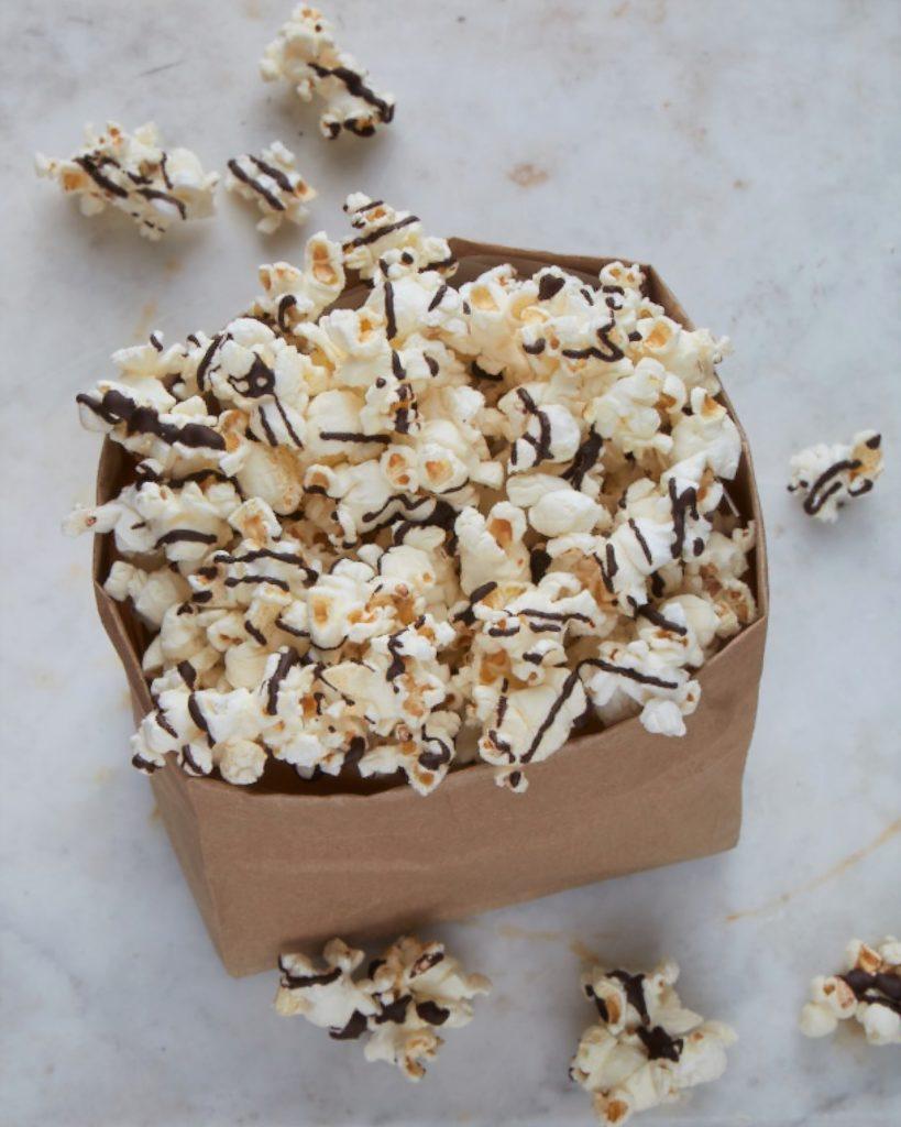 popcorn in a brown paper bag