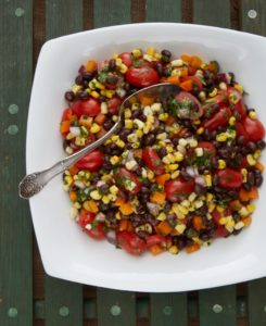 a black bean salad with peppers, onion, grilled corn and cherry tomatoes