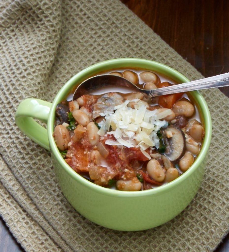 A bowl of a main course white bean soup