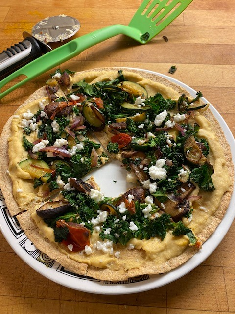 a easy to make pizza using hummus and cooked veggies
